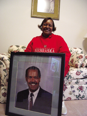 Colleen Jones sits in her home with a picture of her husband Melvin W. Jones. Photo by Troy Fedderson, University...