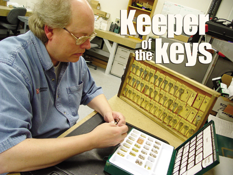 Kim Kramer, a trade supervisor for facilities management and planning at UNL, places pins in a lock. Kramer, who also...