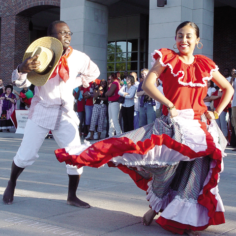 Patrick Kazadi and Liz Santamaria perform a Colombian folk dance during the Fiesta on the Green, outside the Nebraska Union...