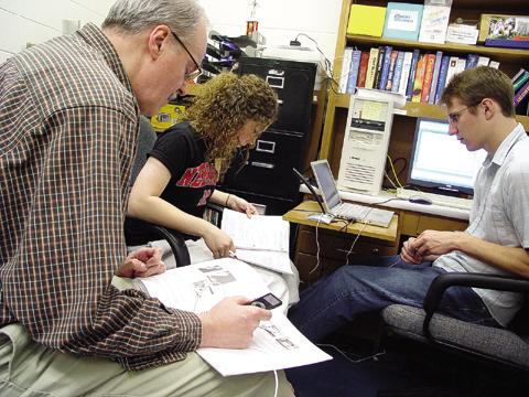 PODCASTERS - Bill McLaughlin listens as students Elizabeth Buehler and Brady Brabec record a podlab on Nov. 18. Buehler, a freshman...