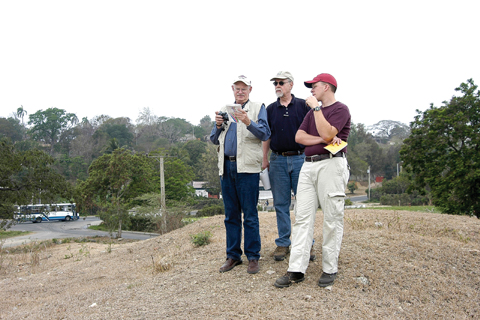 SITE SURVEY - UNL professors (from left) Doug Scott and Peter Bleed join a colleague as they survey a Spanish-American War...