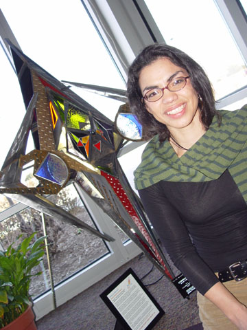 GLASS AND STEEL - Marita Sanchez sits by