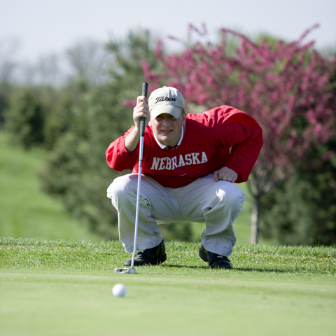 LINING IT UP - Professional golf management major Todd Schaferman, a junior from Hooper, lines up a putt. Photo by Publications...