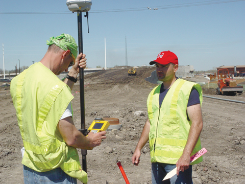 BIG T SURVEY - Don Bosak (left) and Mark Schmit of Speece-Lewis Engineers conduct a site survey April 12 on the...