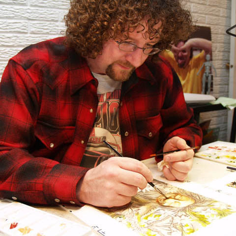 BUILDING UP - Mike Jackson, an illustrator in the Instructional Design Center, applies watercolor to an underdrawing of