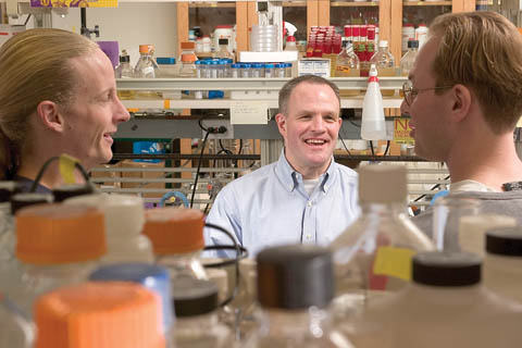 SCIENTIST OF THE YEAR - Alumnus Jay Keasling interacts with students in a lab at the University of California, Berkeley. Keasling...