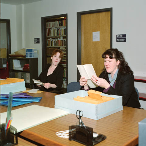 INITIAL REVIEW - University archivists Carmella Orosco (left) and Mary Ellen Ducey read letters from the newly donated Roscoe and Meta...