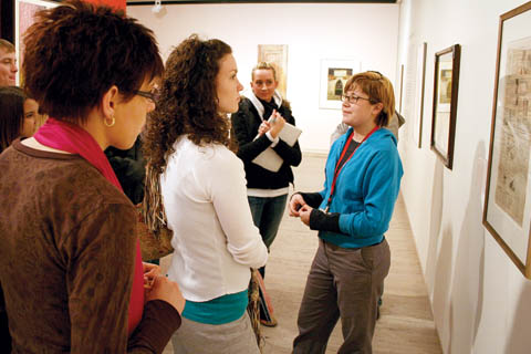 COLLEGE NIGHT - Docent Kestrel Lemen (right), a senior art major from Lincoln, engages students with the question,