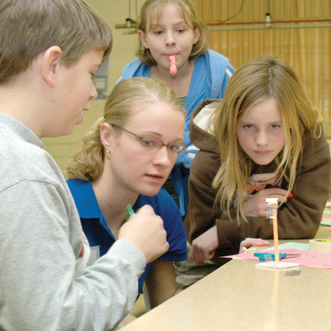 SCIENCE SATURDAY - UNL undergraduate Ann Langemeier (second from left) helps Lincoln Public Schools students (clockwise, from far left) Ben Hartzell...