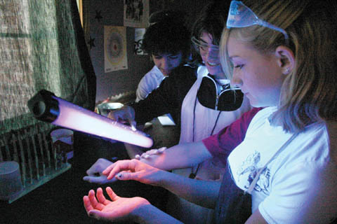 GLOWING PROGRAM - Potter-Dix Public Schools students work with Glo Germ and a black light. The experiment is part of a...