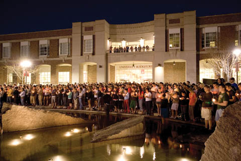 CANDLELIGHT VIGIL - Faculty, staff and students gather around Broyhill Fountain for an April 18 candlelight vigil to mark the April...