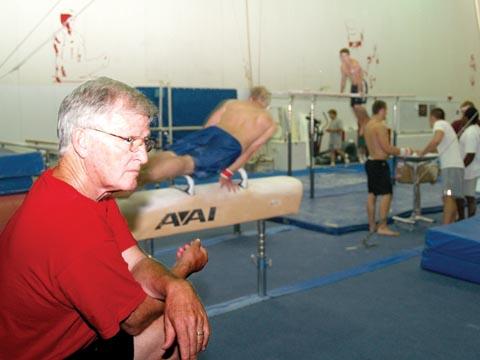 DEDICATED COACH - Husker men's gymnastics coach Francis Allen watches a routine during an Aug. 9 practice. Allen - who was a...