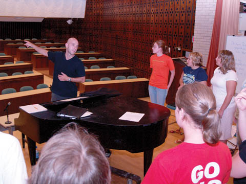 WAY BACK - James Wilson, UNL graduate student and director of the East Campus Choir, tells choir members to sing loud...