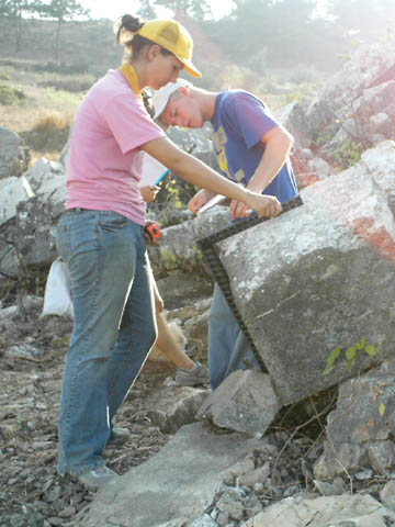 FIELD WORK - UNL students Mary Naughtin and Travis Schafter measure temple blocks at the Gazipasha temple site. The research is...