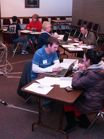 TAX FILERS - Volunteers assist Lincoln-area taxpayers during Student Involvement's first Volunteer Tax Income Assistance session, Jan. 26 in the East...