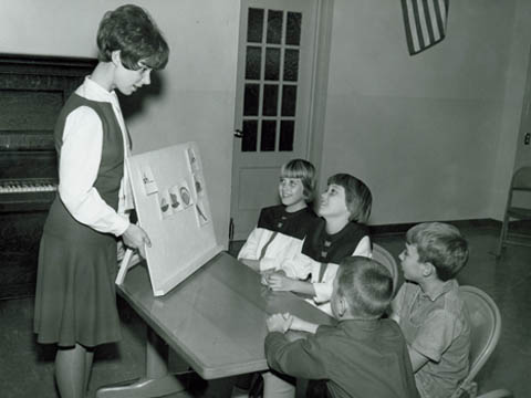 SPEECH LESSON - An unidentified Teachers College undergraduate works with students in this photo from the 1950s.