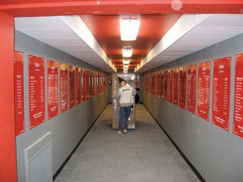 A Von Rentzell employee pushes a rack down the South Stadium hallway that was previously used for the Husker football...