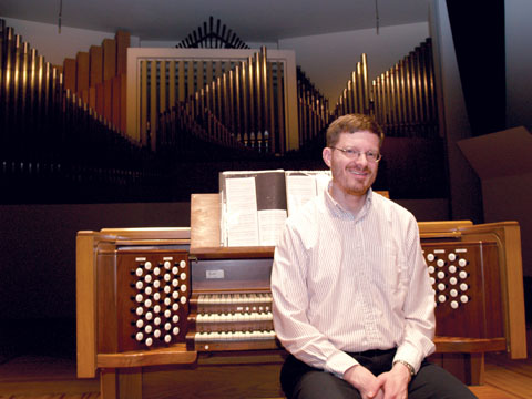 FEATURED PLAYER - Christopher Marks sits at the organ in Kimball Recital Hall. Marks will celebrate the release of his CD...