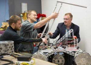 Shane Farritor (right), professor of mechanical engineering, has earned the Innovation, Development and Engagement Award for his collaboration with Dmitry Oleynkiv, a professor of surgery at UNMC.